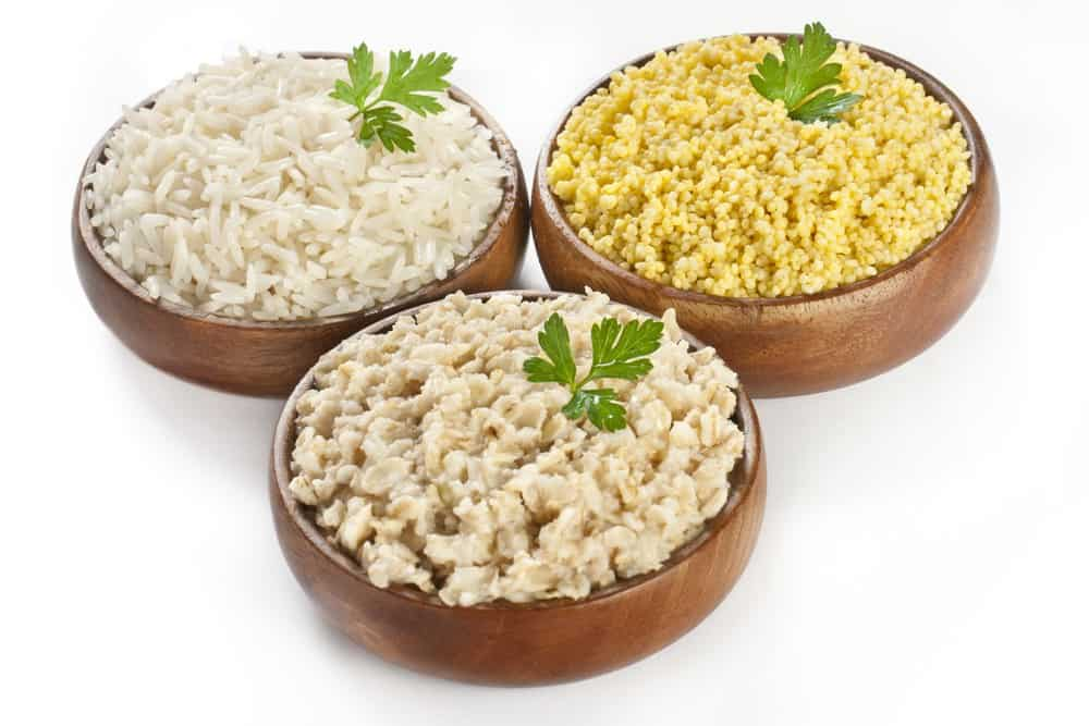 three bowls of different cooked grains