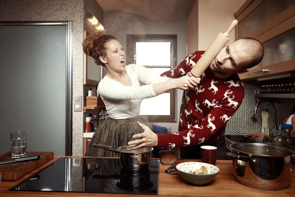 couple fighting in kitchen