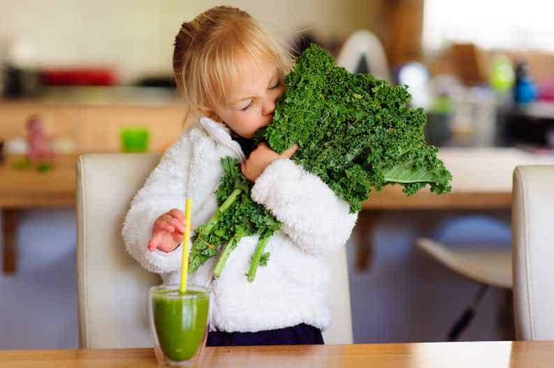 child enjoy her leafy greens