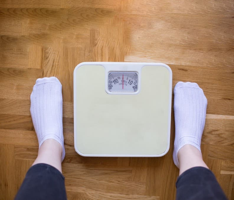 vegan adolescent weighing scales