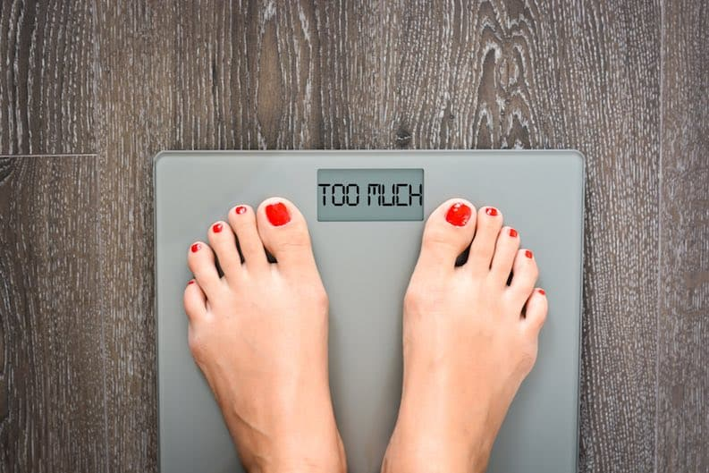 woman on scales too much fat