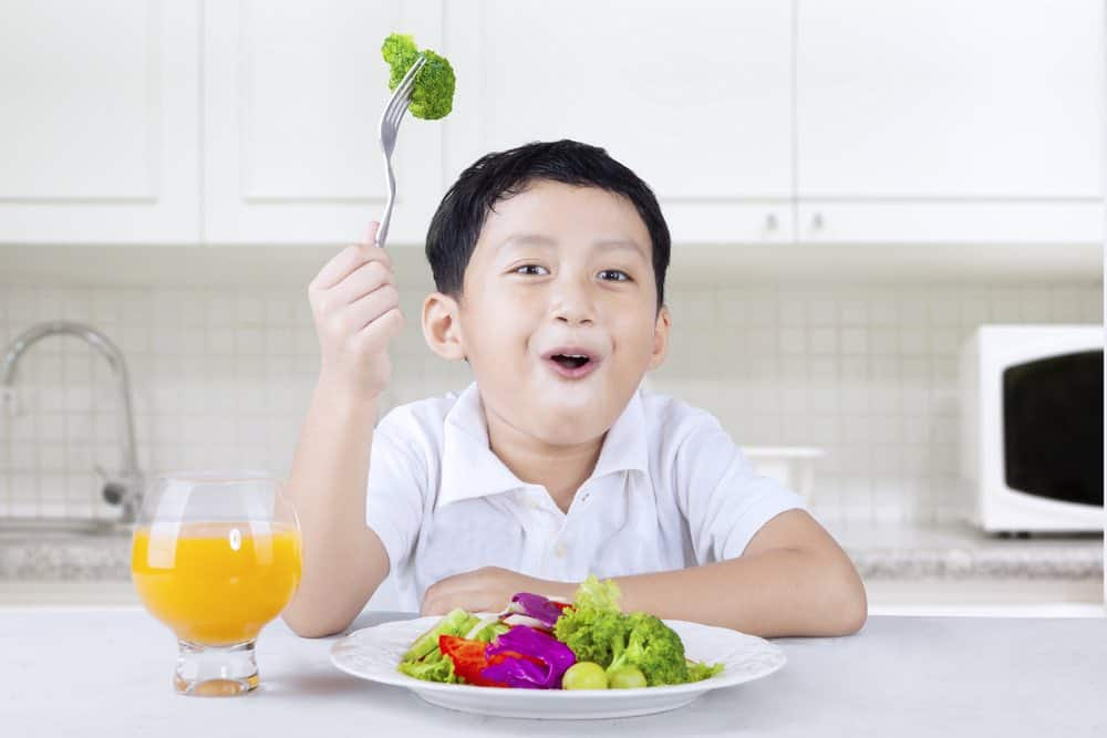 young boy getting nutrients from vegetables
