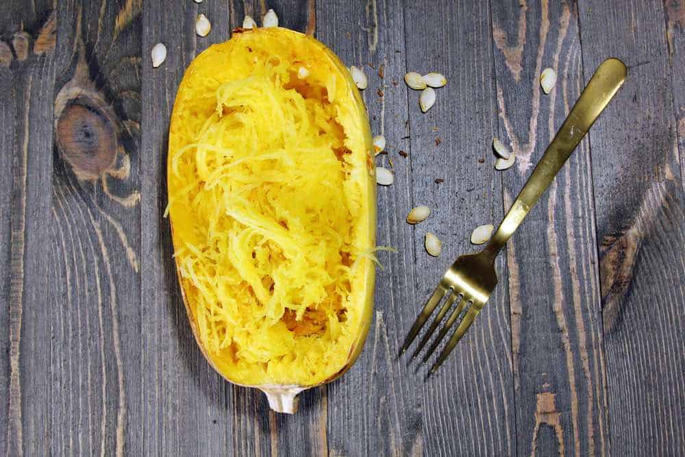 picked spaghetti squash in season cooked and served with a fork
