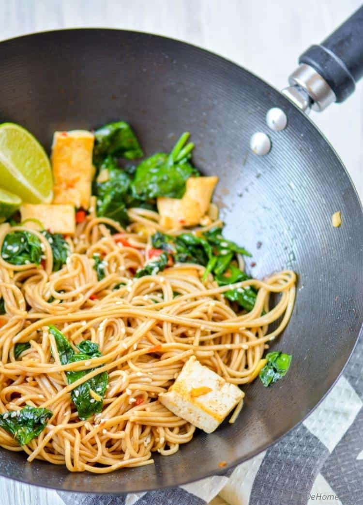 Buckwheat soba noodles with spinach, lime, coconut, and tofu