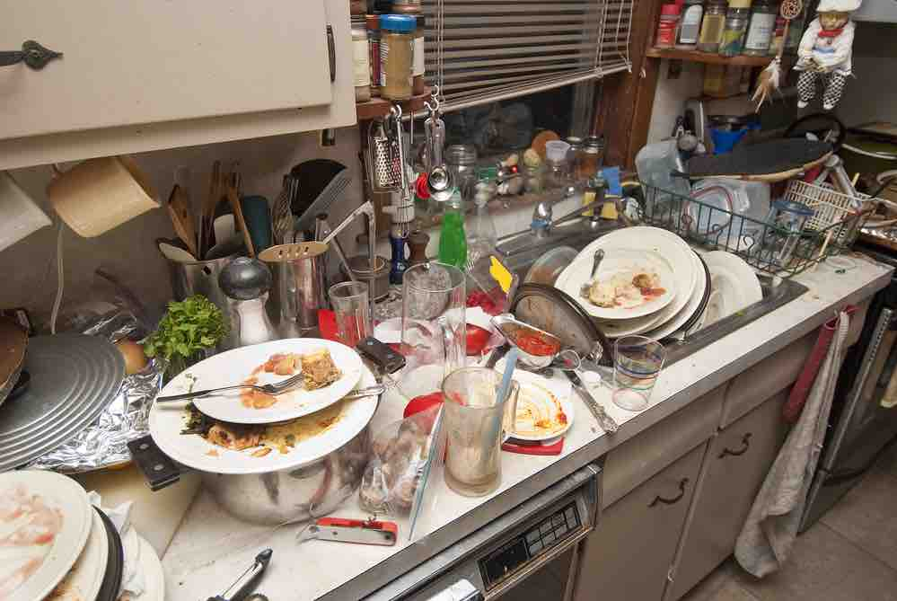 Dirty kitchen with filthy plates - perfect for rodents