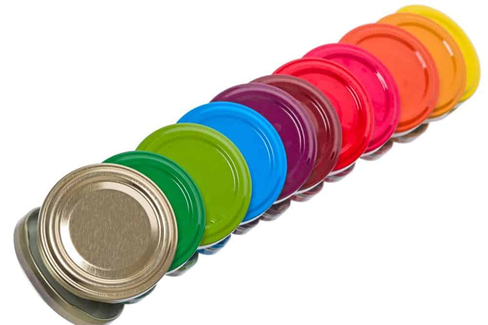 11 Mason jar lids of assorted colors