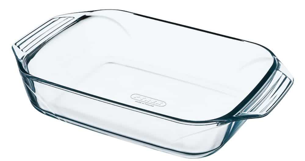 Empty Pyrex roasting dish against a white background