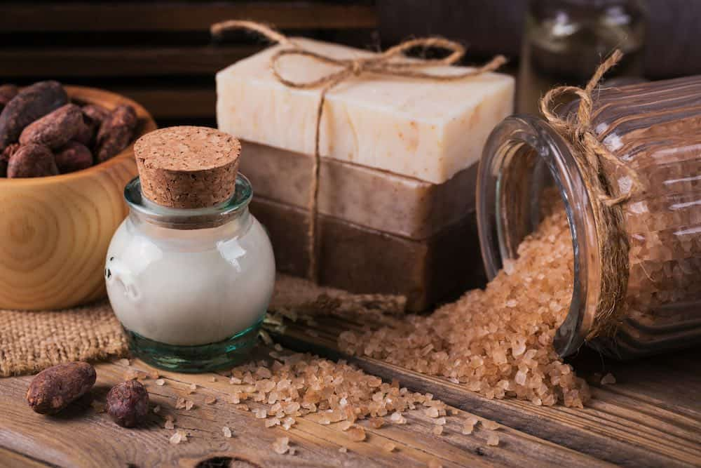 Homemade cosmetics made with cocoa butter on a wooded table