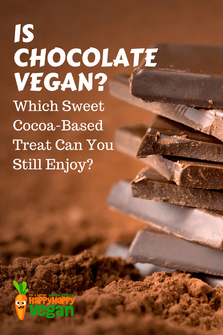 """Squares of chocolate stacked on top of cocoa powder for an article on """"can vegans eat chocolate?"""""""