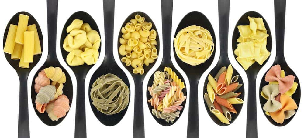 black spoons with various types of pasta on them