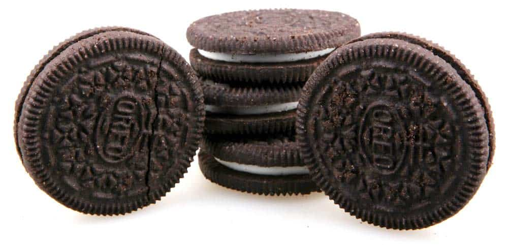 three oreo cookies stacked up with one either side on their ends