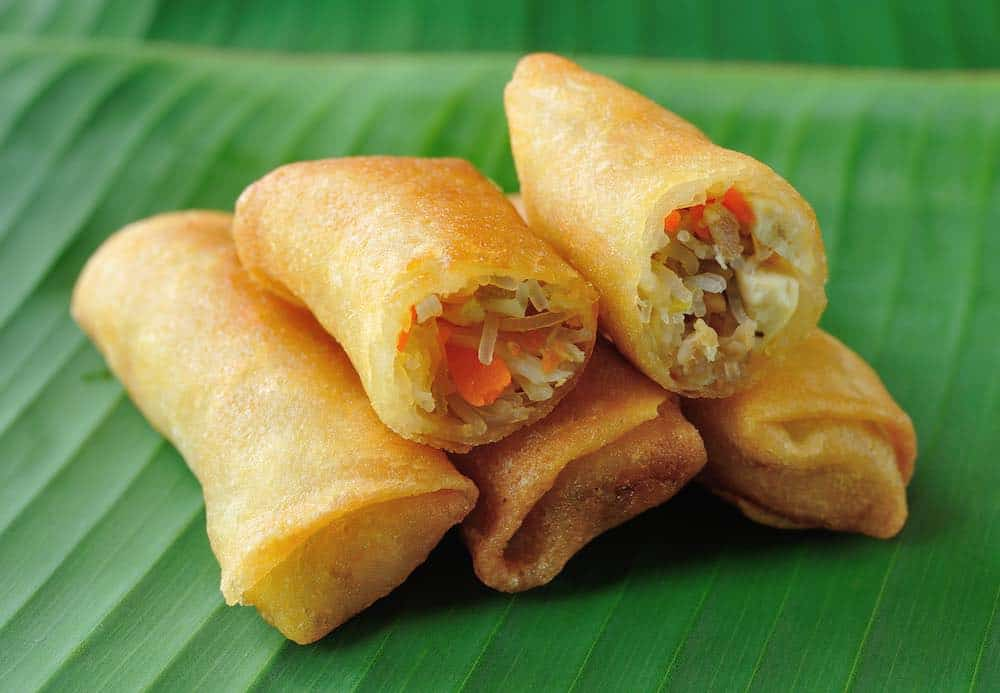 plant-based spring rolls on a banana leaf