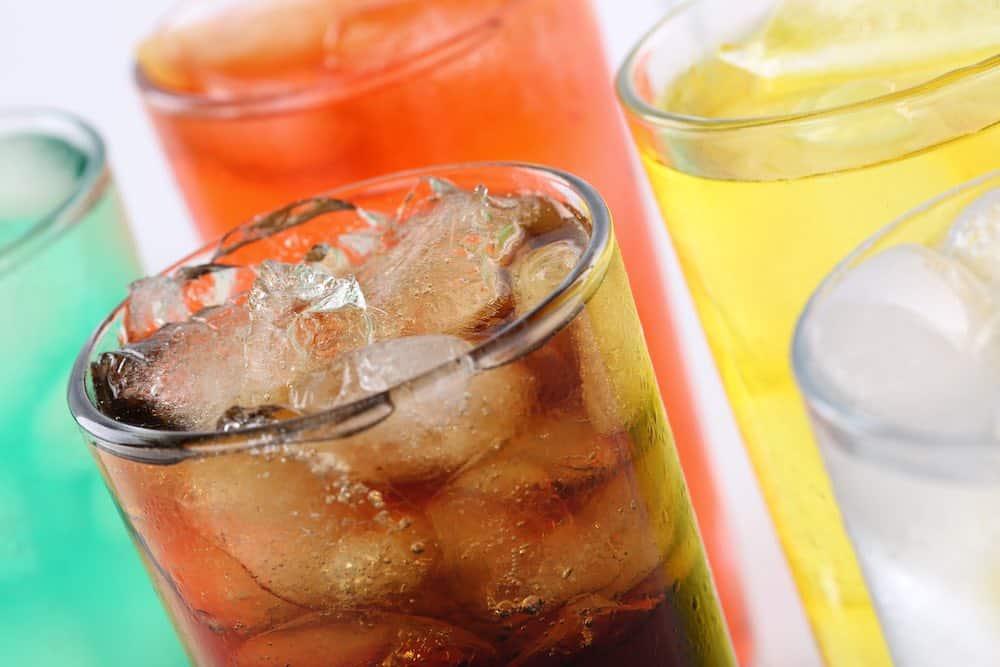 glasses of different iced vegan soft drink beverages