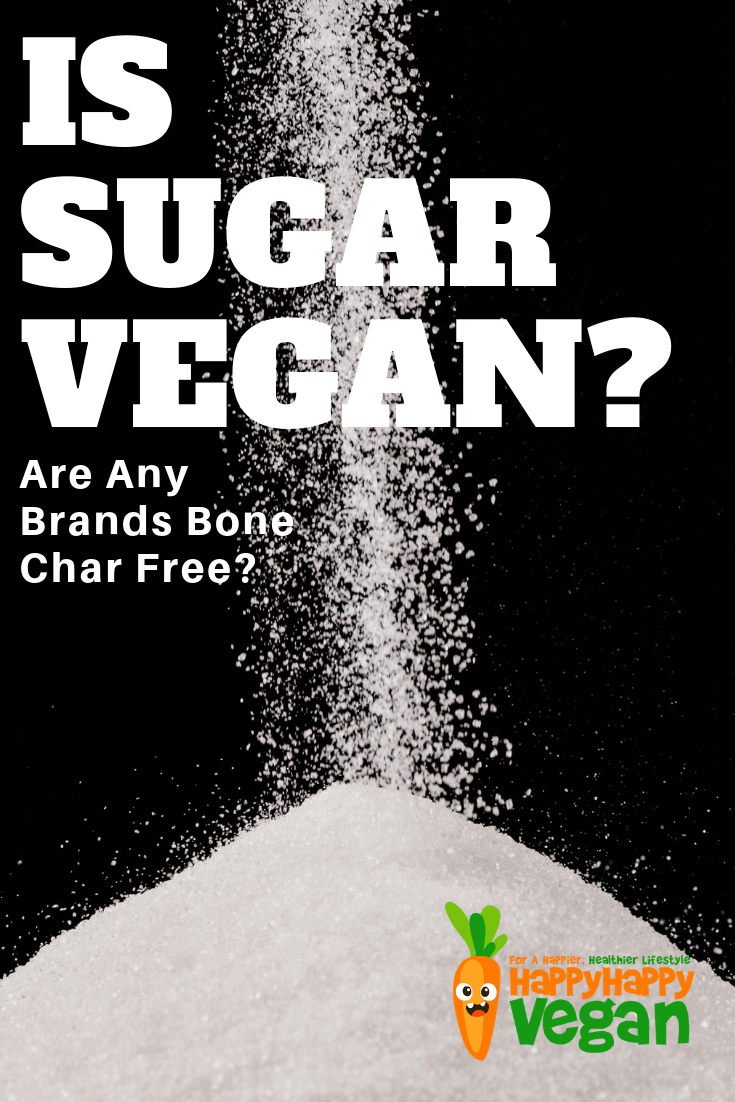 "White sugar being poured against a black background for a Pinterest image of ""can vegans eat sugar?"" article"