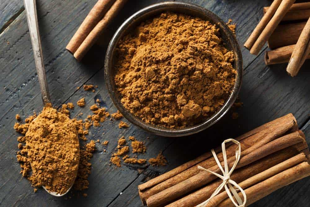 tied cinnamon sticks and powder for essential oils