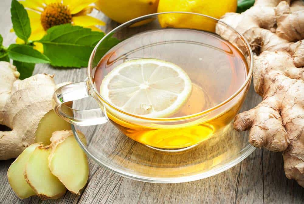 glass cup of ginger tea with lemon - ginger home remedies