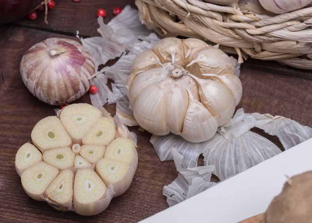how to prepare garlic chopped in half ready for roasting