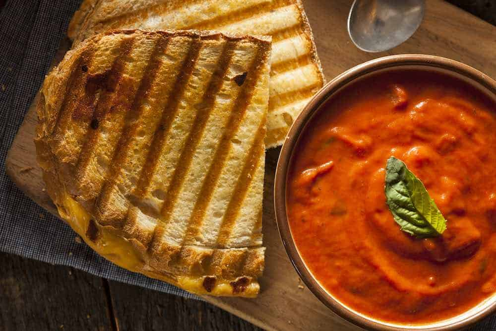 bowl of tomato soup with grilled vegan cheese sandwich made in a sandwich grill