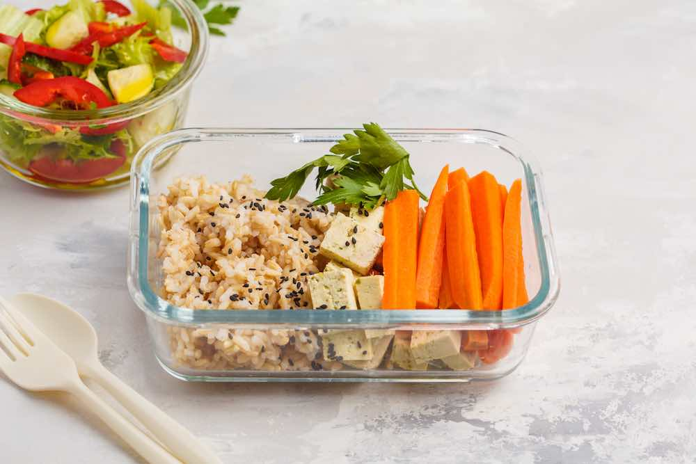 tofu, grains, and carrots in glass meal prep containers