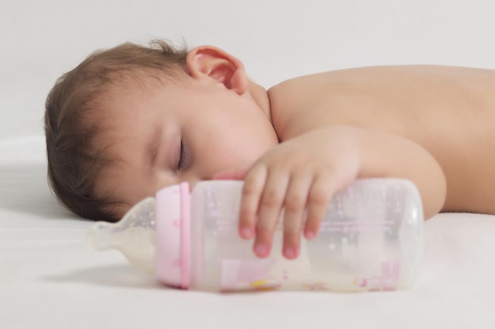 sleeping infant after a bottle of vegan baby formula