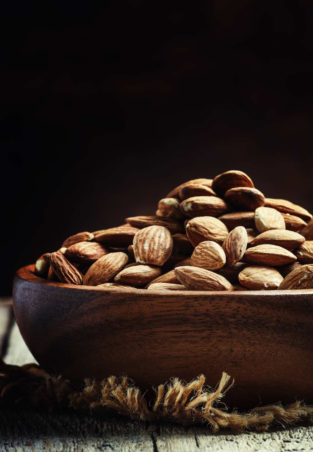arty shot of a bowl of almonds
