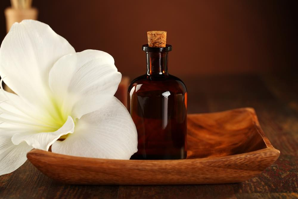 best sensual massage oil in a bottle with flower blossom