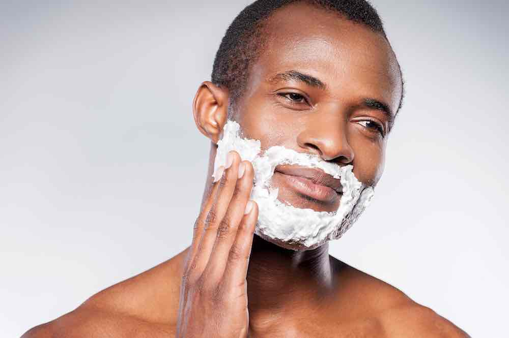 man applying vegan shaving foam
