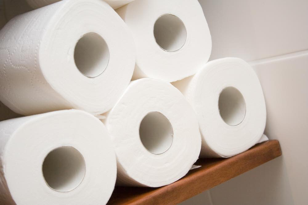 rolls of vegan toilet tissue on shelf