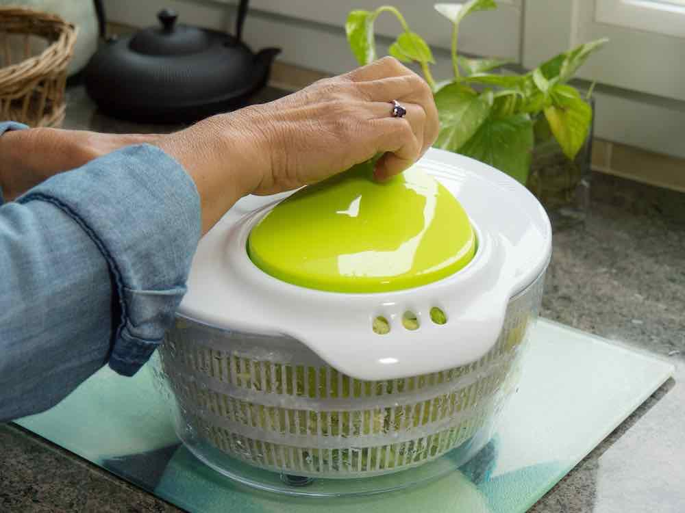 woman using large salad dryer