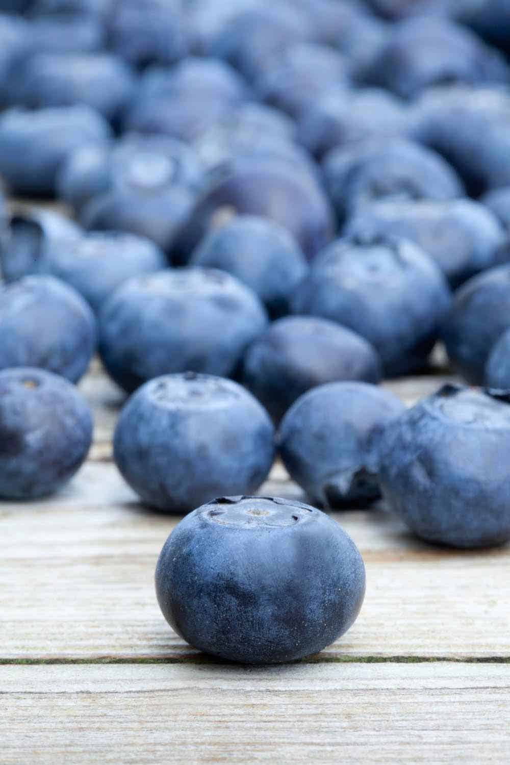 blueberries after harvesting on a wooden table