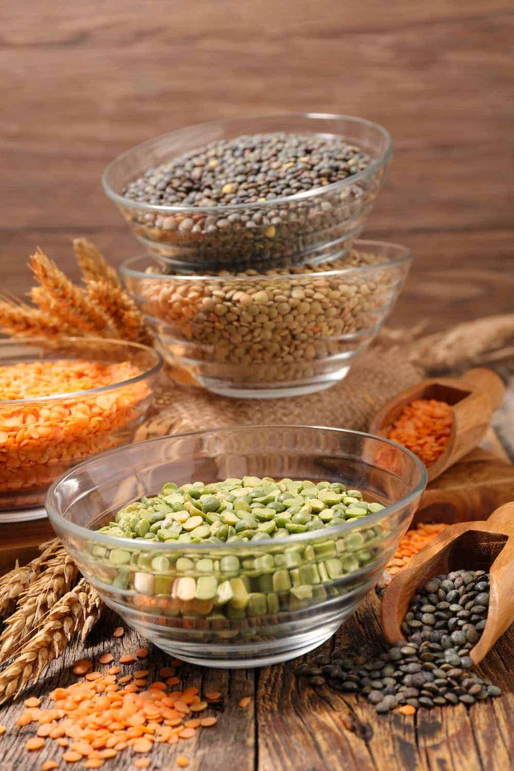 various types of lentil in glass bowls